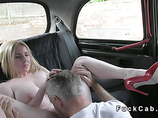 Well-endowed blonde changing in act out taxi