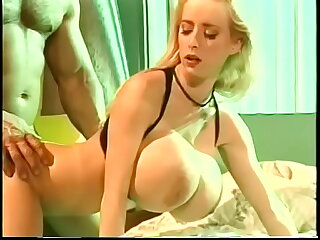 Well-muscled dude fucks busty blonde Wendy Whoppers steadfast doggy style added to cum on her mouth-watering tits